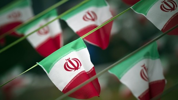 Iran's national flags are seen on a square in Tehran in this file photo taken on February 10, 2012, a day before the anniversary of the Islamic Revolution. (REUTERS/Morteza Nikoubazl/Files)