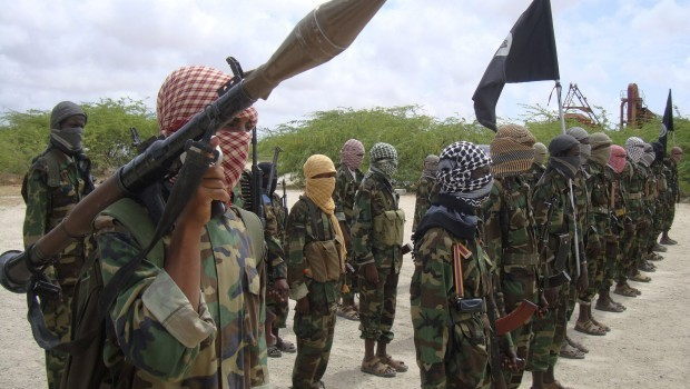 In this file photo from Thursday, October 21, 2010, Al-Shabaab fighters display weapons as they conduct military exercises in northern Mogadishu, Somalia. (AP Photo/Farah Abdi Warsameh-FILE)