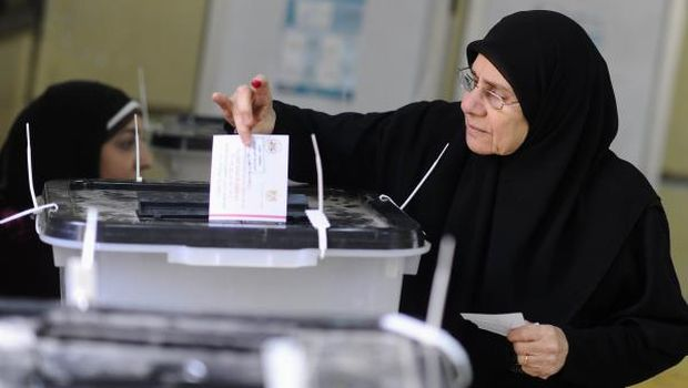 A woman casts her vote at a polling station during a referendum on Egypt's new constitution in Cairo on January 14, 2014. (Reuters/Mohamed Abd El Ghany)