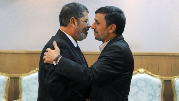 Iranian President Mahmoud Ahmadinejad (R) welcomes his Egyptian counterpart Mohamed Morsi during a meeting on the sidelines of the Non-Aligned Movement summit in Tehran on August 30, 2012 . (SAJAD SAFARI/AFP/GettyImages)