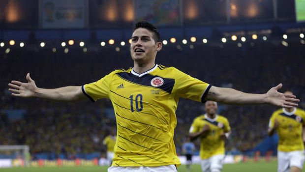 a2dfafe4f03 Colombia's James Rodríguez celebrates after scoring the opening goal during  the World Cup round of 16 soccer match between Colombia and Uruguay at the  ...