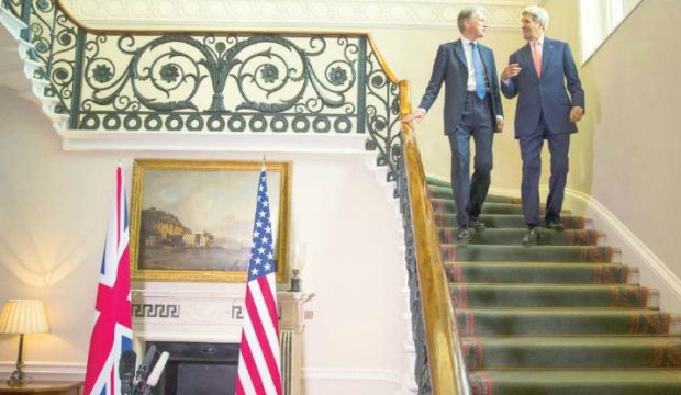 US says Assad must go, timing down to negotiation