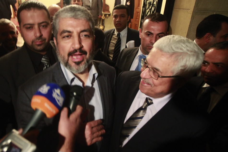 Hamas leader Khaled Meshaal and Palestinian President Mahmoud Abbas speak to the media after their meeting in Cairo. REUTER/Asmaa Waguih