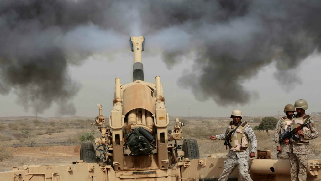Saudi soldiers fire artillery toward three armed vehicles approaching the Saudi border with Yemen in Jazan, Saudi Arabia, Monday, April 20, 2015.