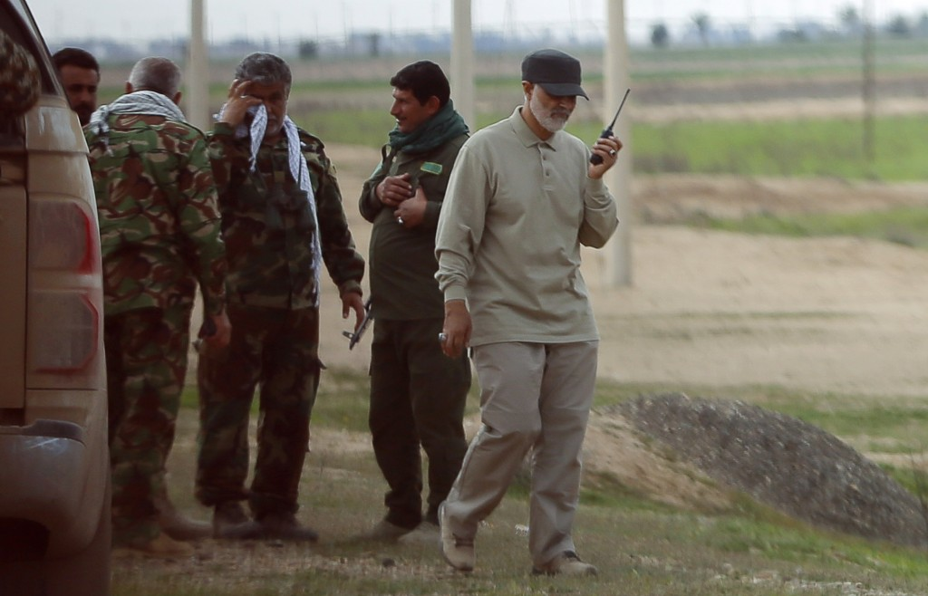 Iranian Revolutionary Guard Commander Qassem Soleimani uses a walkie-talkie at the frontline during offensive operations against Islamic State militants in the town of Tal Ksaiba in Salahuddin province, March 8, 2015. REUTERS/Stringer