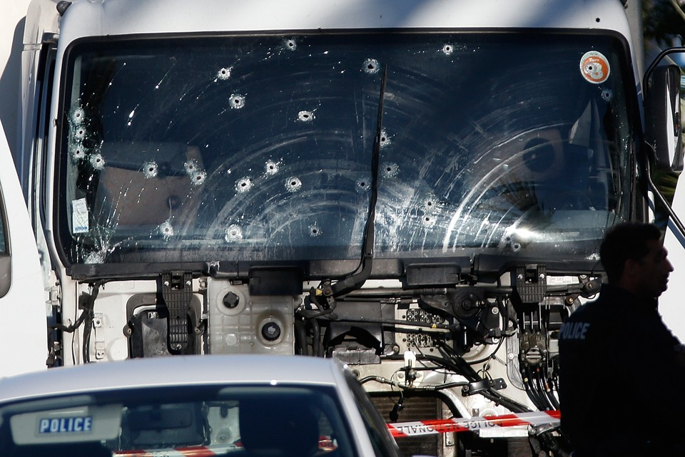 Bullet imacts are seen on the heavy truck the day after it ran into a crowd at high speed killing scores celebrating the Bastille Day July 14 national holiday on the Promenade des Anglais in Nice, France, July 15, 2016. REUTERS/Eric Gaillard - RTSI17P