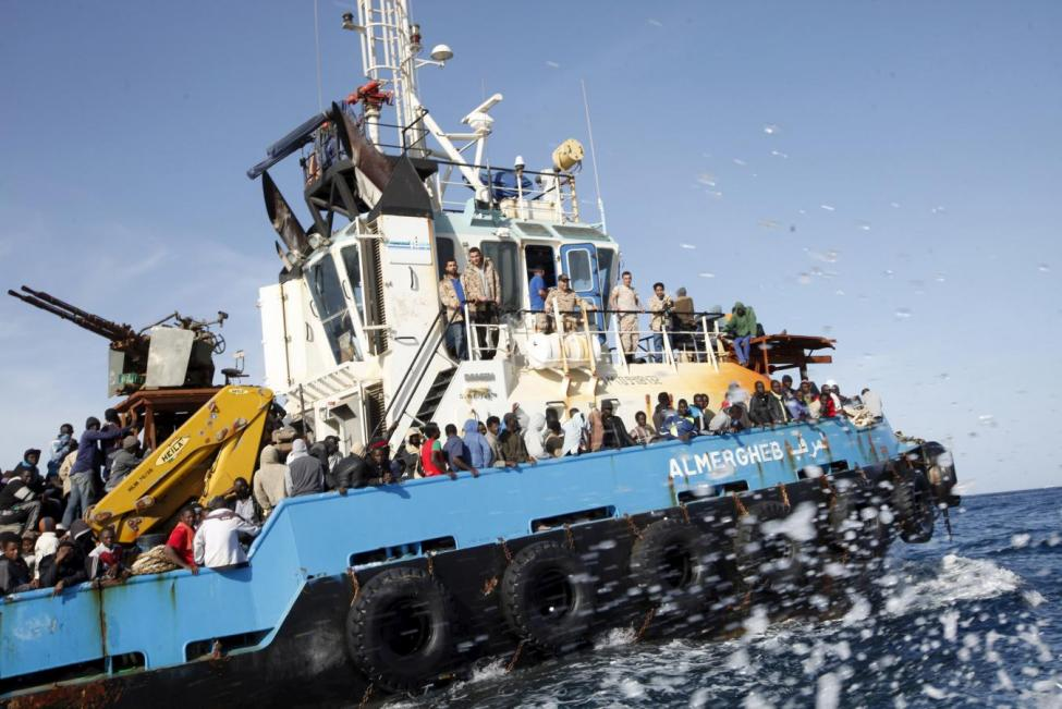 A Libyan Navy boat carries migrants back to the coastal city of Misrata May 3, 2015. The North African country, gripped by violence and a breakdown of state authority four years after the ousting of Muammar Gaddafi, has turned into a major hub for human traffickers smuggling African migrants by boat to Italy. REUTERS/Ismail Zitouny
