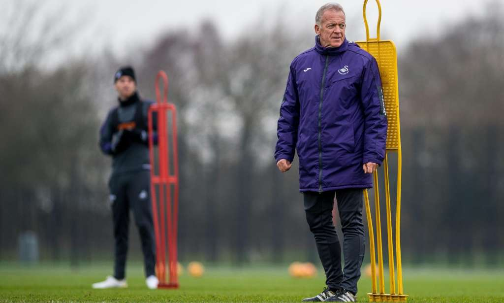 Swansea's coach and current caretaker Alan Curtis keeps an eye on proceedings in training.