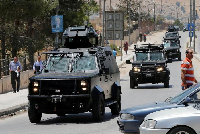 Jordanian security vehicles seen near the General Intelligence directorate offices near al Baqaa Refugee Camp