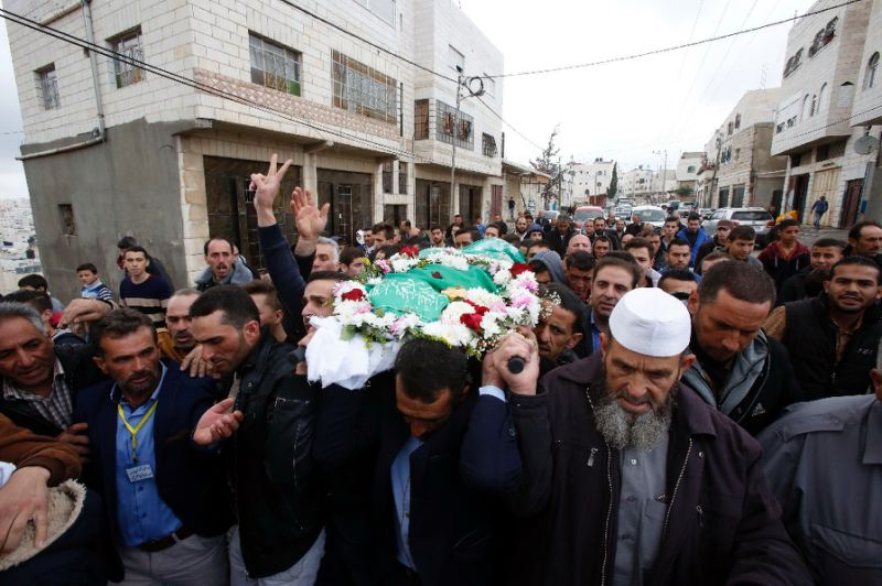 Relatives and friends chant slogans during the funeral of Abdul Fatah al-Sharif, a wounded Palestinian assailant who was shot dead by an Israeli soldier in the city of Hebron in March in the West Bank city of Hebron, on May 28, 2016