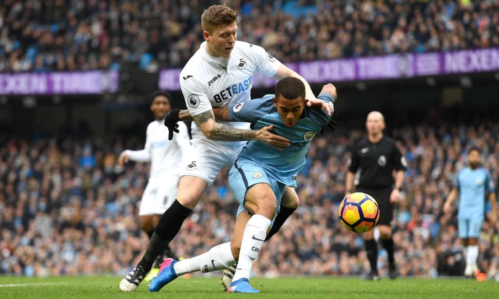 Mawson battles with the Manchester City forward Gabriel Jesus during Swansea's 2-1 defeat at the Etihad.