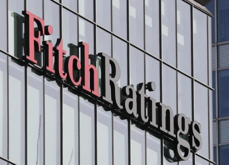 The Fitch Ratings logo is seen at their offices at Canary Wharf financial district in London