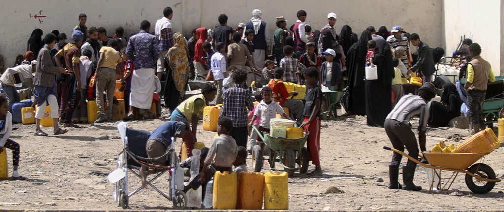 April 20, 2015: People queue to fill containers with water amid an acute shortage of clean drinking water in Sana'a. Mohamed al-Sayaghi/Reuters