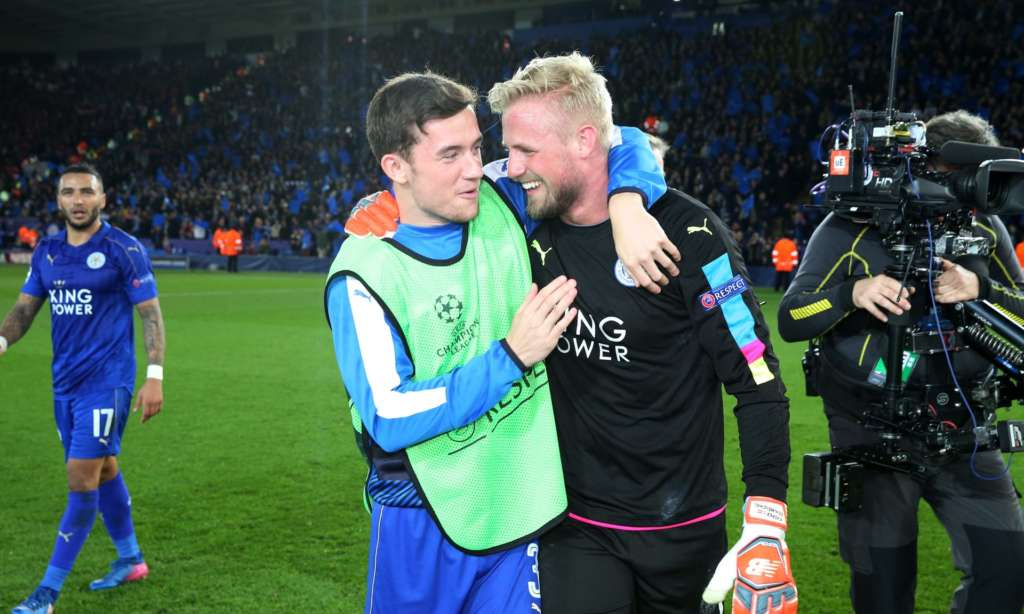 Kasper Schmeichel is congratulated by team-mate Ben Chilwell after helping his team reach the Champions League quarter-finals.
