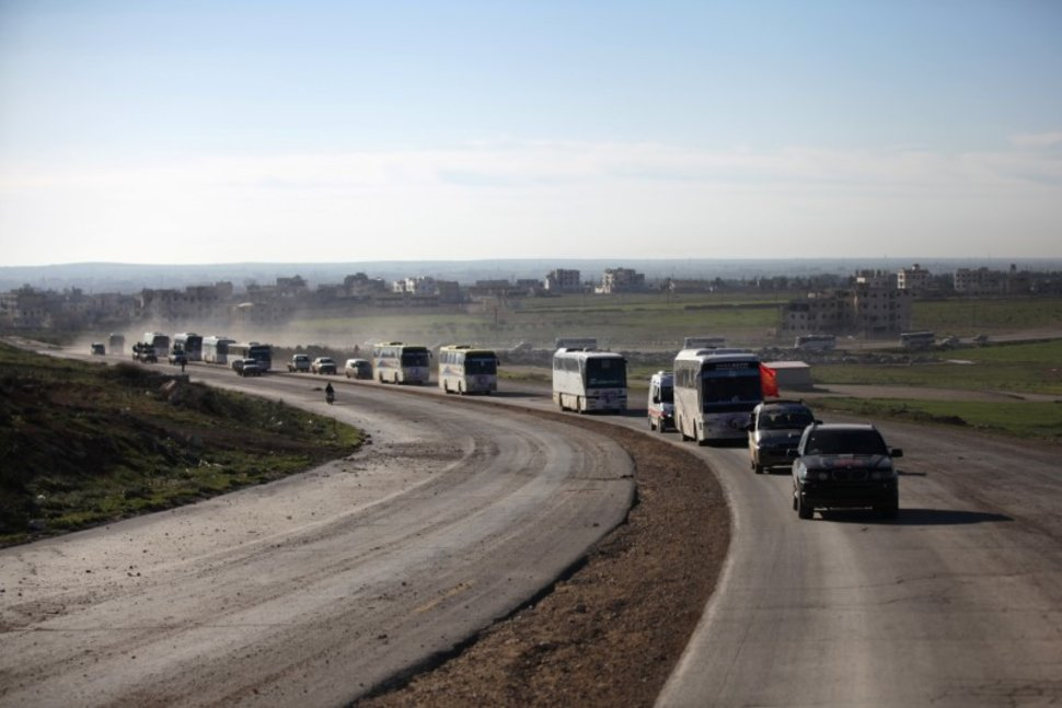 More Syrian Rebels, Families Evacuate Homs under Regime Deal