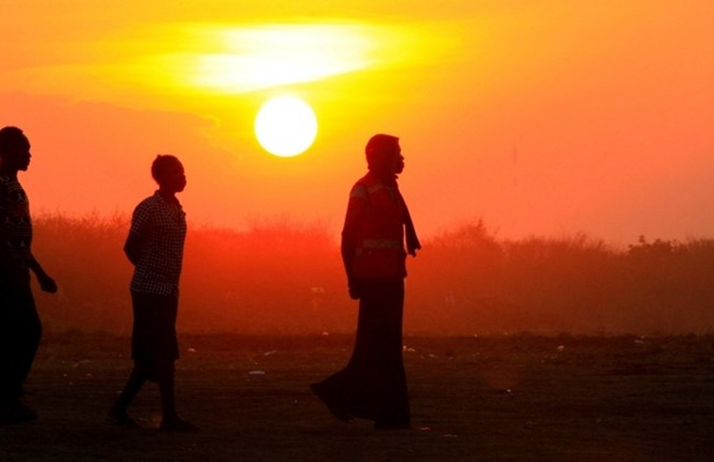People who fled fighting in South Sudan are seen walking at sunset on arrival at Bidi Bidi refugee resettlement camp near the border with South Sudan, in Yumbe district, northern Uganda December 7, 2016.