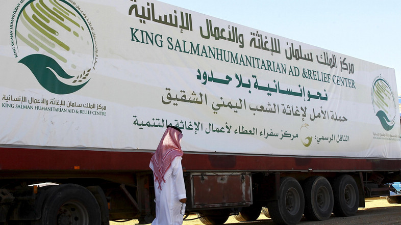 A saudi man walks next to a truck loaded with aid offered by King Salman Center for Relief and Humanitarian Aid to be sent to the Yemeni people, in Riyadh April 17, 2016. REUTERS/Faisal Al Nasser - RTX2ACFF