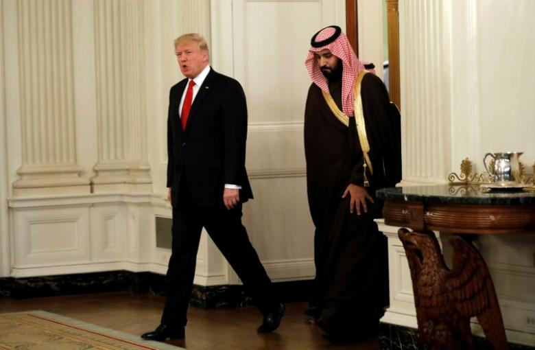 US President Donald Trump and Saudi Deputy Crown Prince and Minister of Defense Mohammed bin Salman enter the State Dining Room of the White House in Washington, US, March 14, 2017. REUTERS/Kevin Lamarque