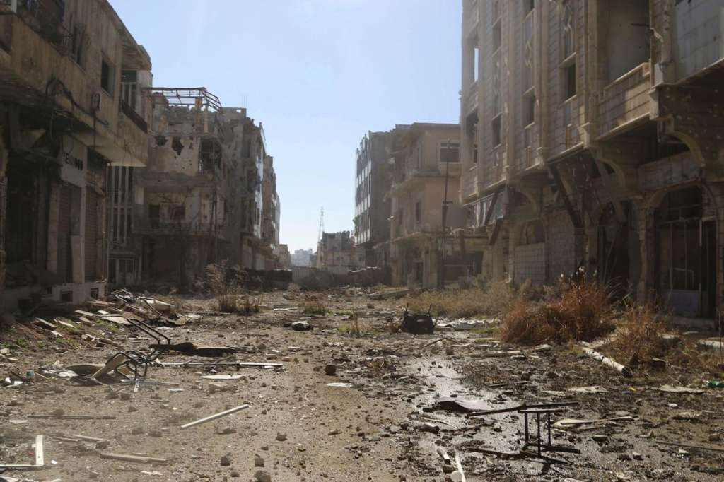 Caption:A bombed-out street in Daraa