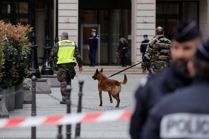 French gendarmes with a detection dog and police stand in front of the French financial prosecutor's offices following a bomb alert in central Paris, France, March 20, 2017. REUTERS/Benoit Tessier