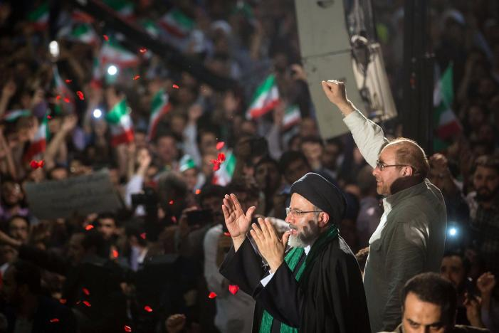 FILE PHOTO: Iranian Presidential candidate Ebrahim Raisi and Tehran Mayor Mohammad Baqer Qalibaf gesture during a campaign meeting at the Mosalla mosque in Tehran
