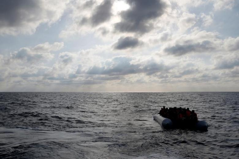 Migrants in a dinghy await rescue by the Migrant Offshore Aid Station around 20 nautical miles off the coast of Libya