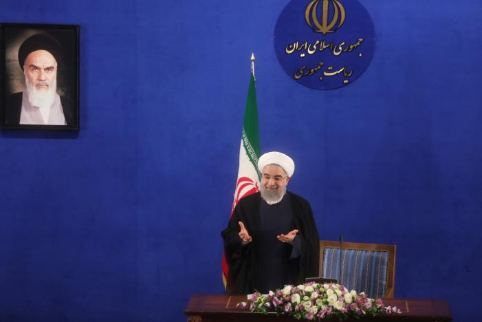 Iranian president Hassan Rouhani gestures during a news conference in Tehran