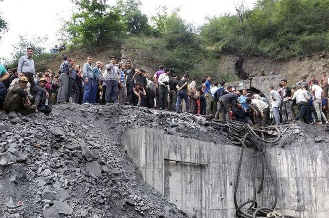 People gather at the site of an explosion in a coal mine in Golestan Province, in northern Iran.