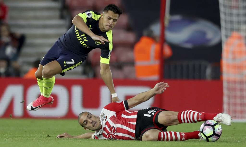Oriol Romeu, here taking to the turf to battle with Arsenal's Alexis Sánchez, was among the Southampton players who had the best season of their careers under Claude Puel.