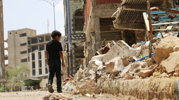 A boy walks near the rubbles of houses destroyed during fighting between tribal fighters and Houthis militias in Taiz, Yemen.