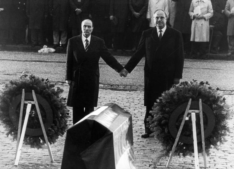 FILE PHOTO 22SEP84 - Helmut Kohl (R) stands hand in hand with former French President Francois Mitte..