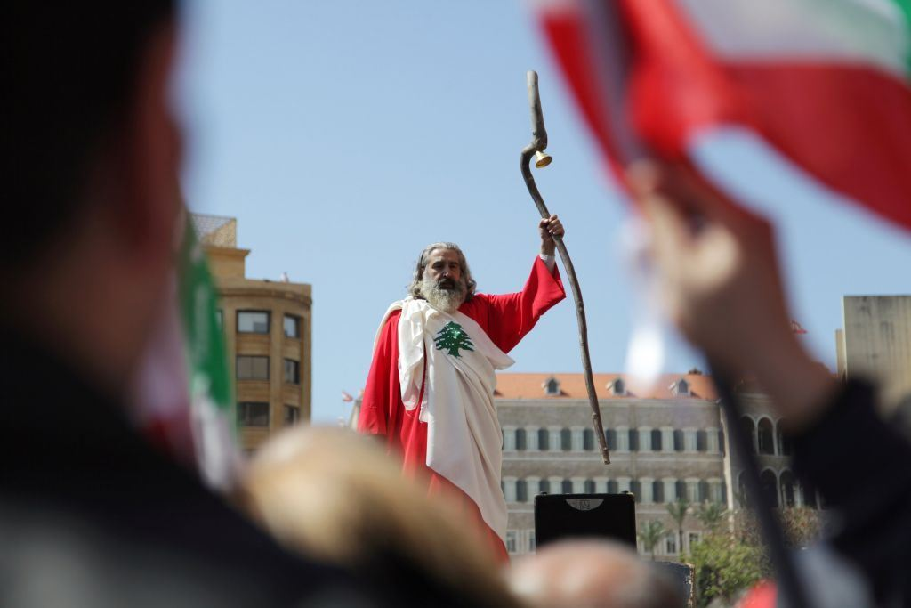 A man dressed up in a Lebanese flag attends a demonstration against proposed tax increase, in Beirut.