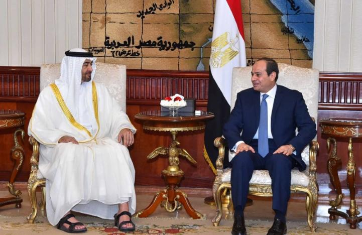 Egyptian President Abdel Fattah al-Sisi speaks with Abu Dhabi Crown Prince Sheikh Mohammed bin Zayed al-Nahyan after he arrives with delegation members in Cairo