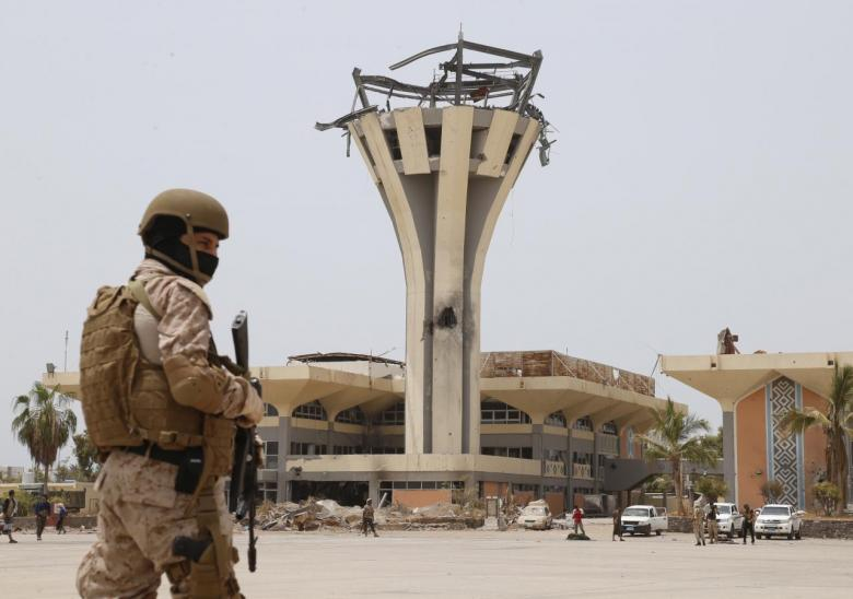Saudi soldier stands guard at the international airport of Yemen's southern port city of Aden