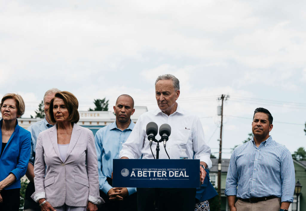 Senator Chuck Schumer of New York, flanked by fellow Democrats, including Nancy Pelosi, second from left. and Elizabeth Warren, far left, introduced the party's new economic message on Monday in Berryville, Va.