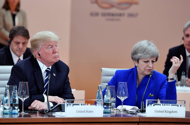 US President Donald Trump and Britain's Prime Minister Theresa May sit at the start of the first working session of the G20 meeting in Hamburg, Germany, July 7, 2017.