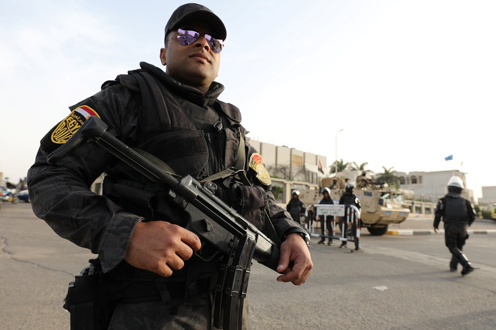 A security personnel stands guards during Pope Francis' visit, in Cairo