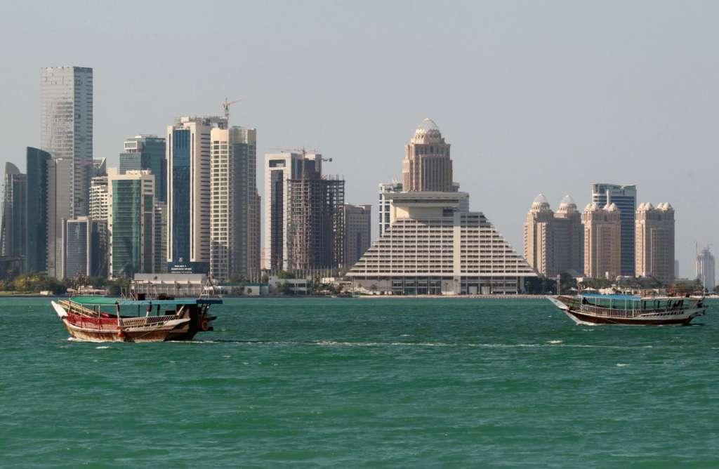 Buildings are seen on a coast line in Doha