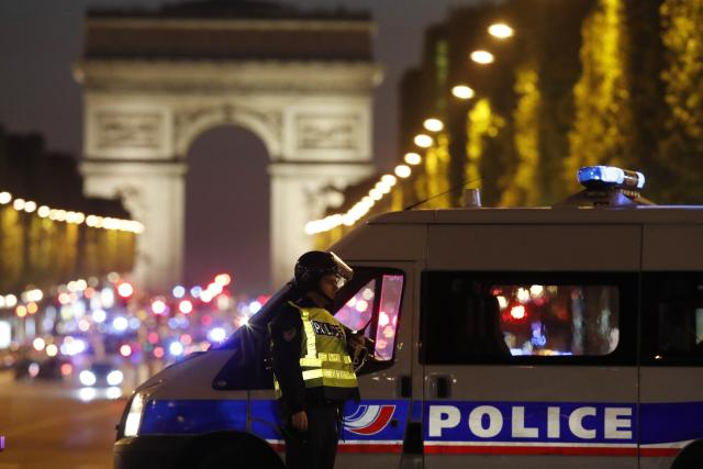 Police secure the Champs Elysees Avenue after one policeman was killed and another wounded in a shooting incident in Paris, France