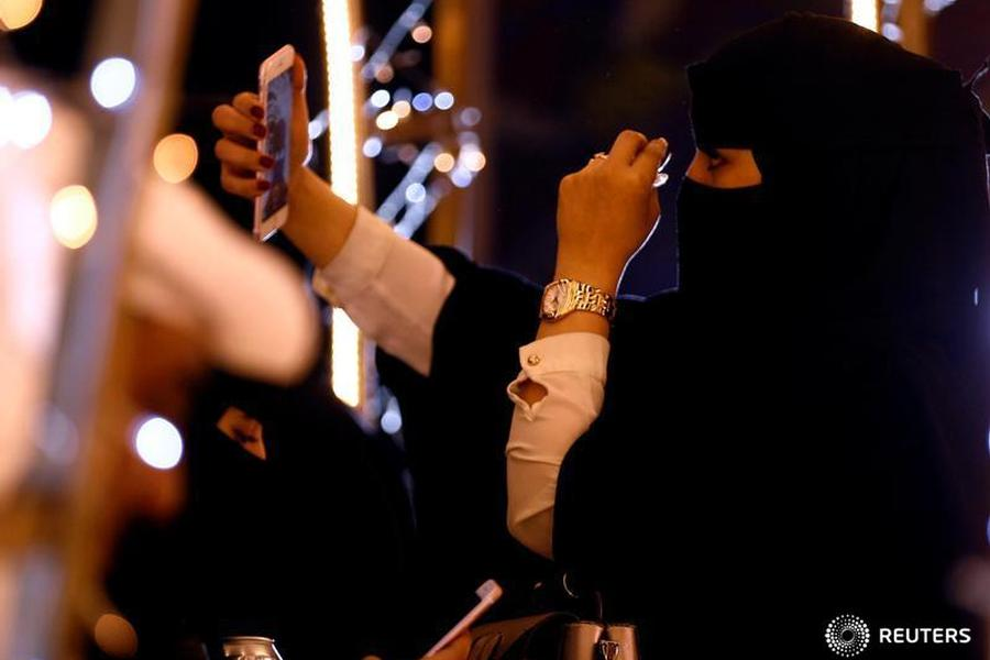 Woman takes a selfie during during celebrations for naming Abha as 'Capital of Arab Tourism'