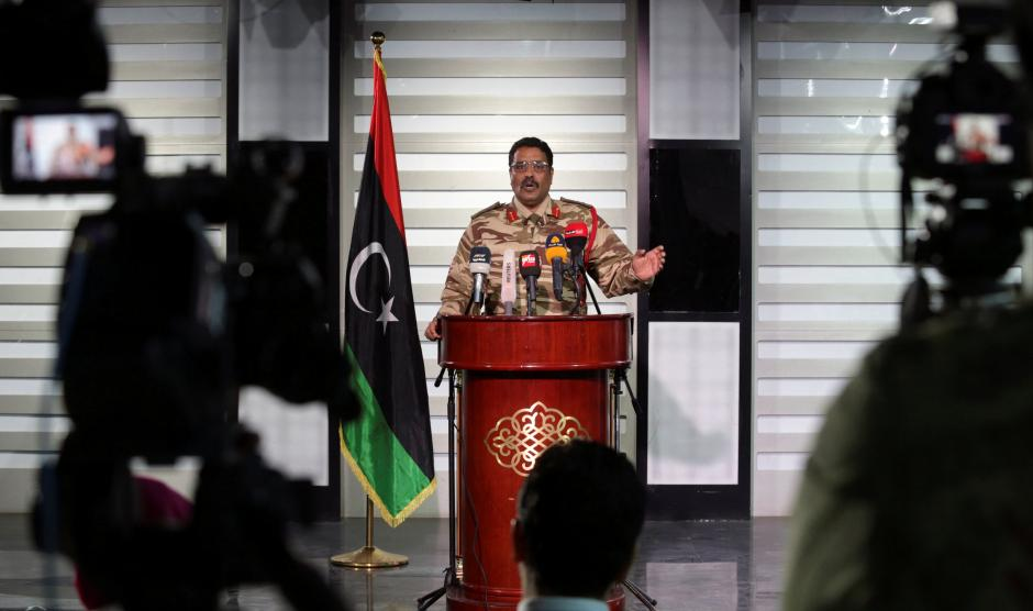 Spokesman of LNA colonel Ahmed Al Masmary gestures during a news conference in Benghazi