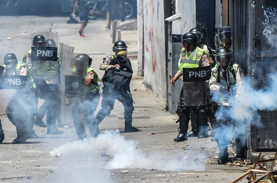 Venezuelan police clash with opposition activists during a protest against the government of President Nicolas Maduro in Caracas.
