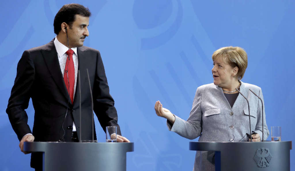 German Chancellor Angela Merkel, right, and Qatar's Emir Sheikh Tamim Bin Hamad Al Thani, left, address the media during a joint news conference as part of a meeting at the chancellery in Berlin, Germany, Friday, Sept. 15, 2017.