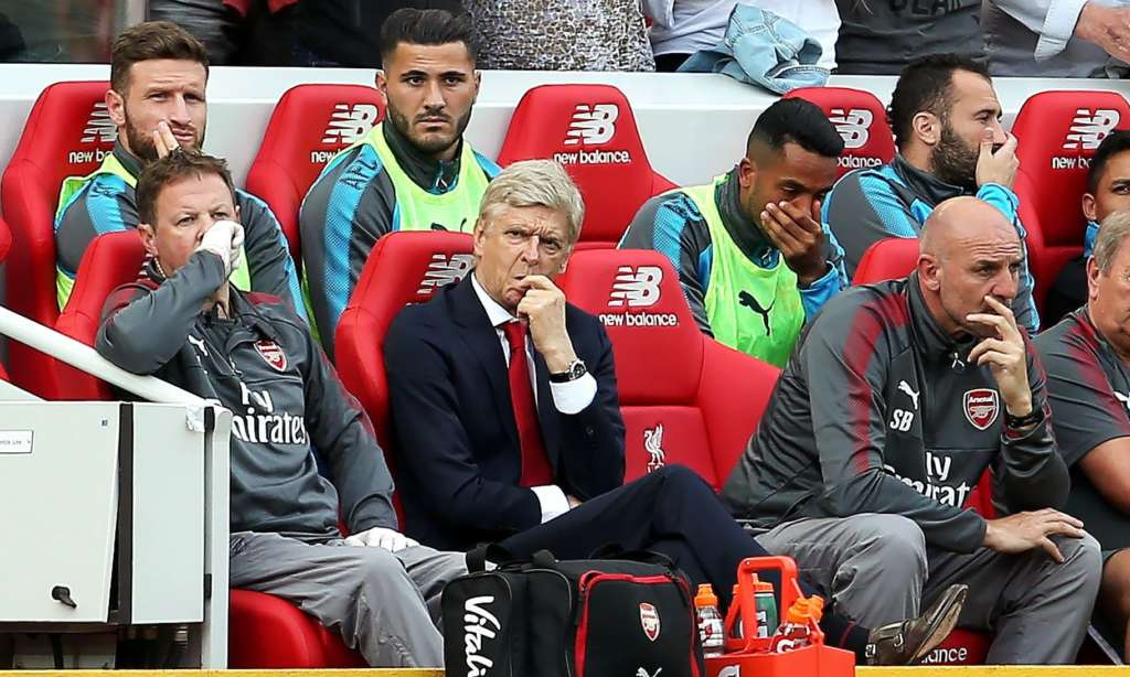 Arséne Wenger and the Arsenal bench feel the strain at Anfield.