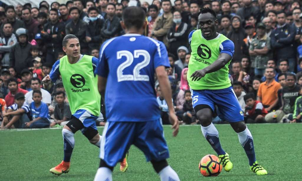Michael Essien is watched by thousands of fans during practice for Persib Bandung, where he reportedly earns an annual salary of $750,000, around £10,000 a week.