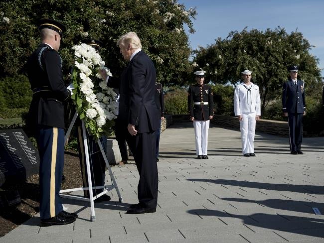 US President Donald Trump places a wreath during a memorial service at the Pentagon.