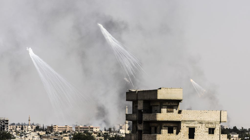 Smoke is seen following an airstrike on the western frontline of Raqqa on July 17, during an offensive by the US-backed Syrian Democratic Forces, a majority Kurdish and Arab alliance, to retake the city from ISIS fighters.