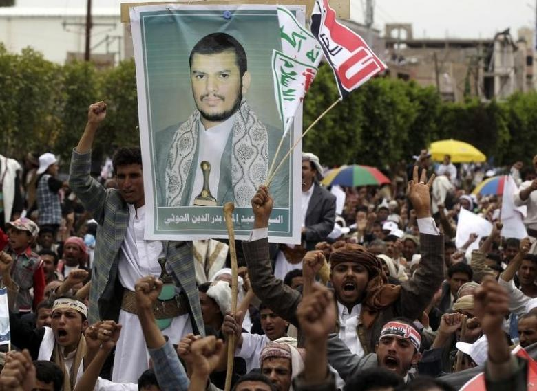 Supporters of the Shi'ite Houthi attend hold a poster of the group's leader Abdul-Malik al-Houthi during an anti-government rally in Sanaa