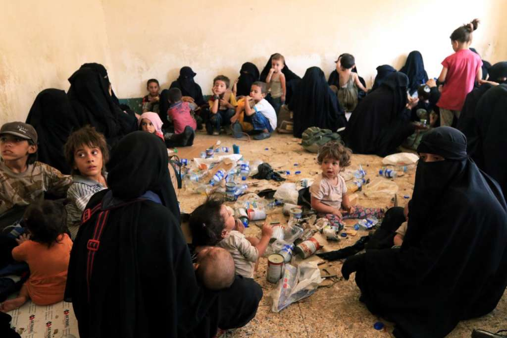 Families and relatives of ISIS militants are see after they surrender themselves to the Kurdish Peshmerga forces in al-Ayadiya, northwest of Tal Afar
