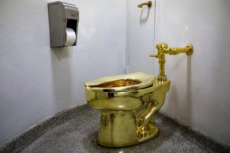 "Maurizio Cattelan's ""America,"" a fully functional solid gold toilet is seen at The Guggenheim Museum in New York"